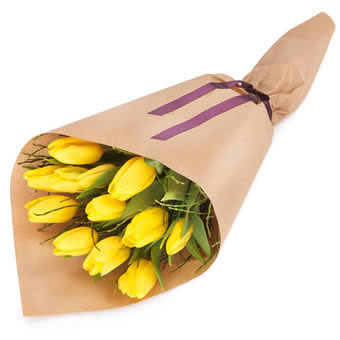 Gift wrapped yellow tulips