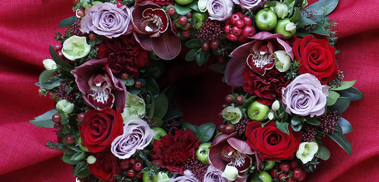 Send en julekrans fyldt med glæde